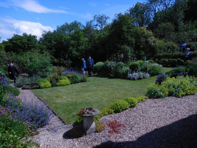 Visitors enjoying the open gardens in Chedworth