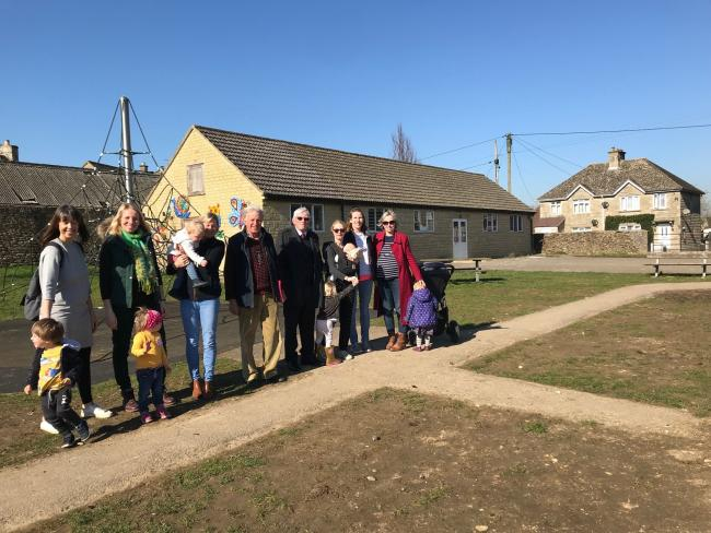 Pre-school committee members and Sherston parents in front of the site