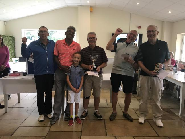 Guy assisted by his grandson, Fabrice, presenting winners: Bryan, Danny, Keith and Dave with the winners' trophy.