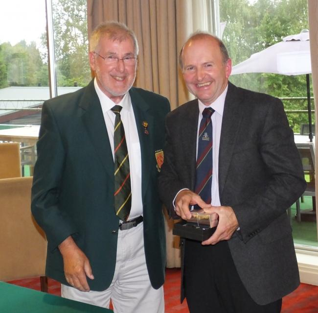 Pete Stone, right, of Cirencester Golf Club, is presented with his prize for winning Division One of the Seniors' County Stableford Final at Chipping Sodbury by Ian Cornwell, chairman of the Gloucestershire Golf Union