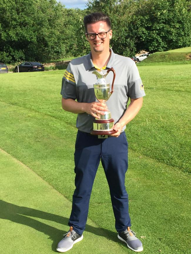Charlie Harraway, seen here with his Club Championship trophy at Cirencester Golf Club earlier this year, has now added the Scratch Cup to his list of 2019 victories