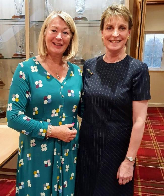 Fiona Fyfe, left, lady captain at Cirencester Golf Club in 2019, passed on the captain's brooch to her successor Erika Brooke