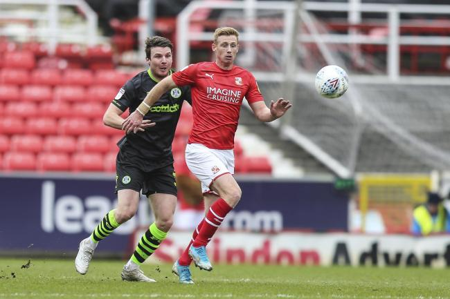 Swindon Town's Eóin Doyle(28) and Forest Green Rovers Chris Stokes(30) during the EFL Sky Bet League 2 match between Swindon Town and Forest Green Rovers at the County Ground, Swindon, England on 7 March 2020.