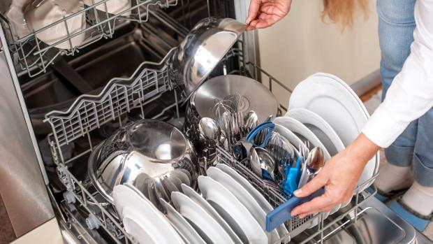 Wilts and Gloucestershire Standard: This dishwasher looks like it's already full, but the owner can't resist adding another bowl. Don't do this if you want your dishes to get clean. Credit: Getty Images / CasarsaGuru