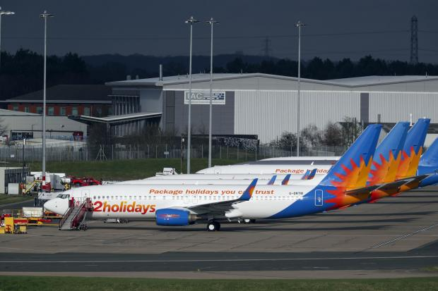 Wilts and Gloucestershire Standard: AIRLINE: Several Jet2 planes have been parked up at Birmingham Airport during the pandemic. Picture: Steve Parsons/PA