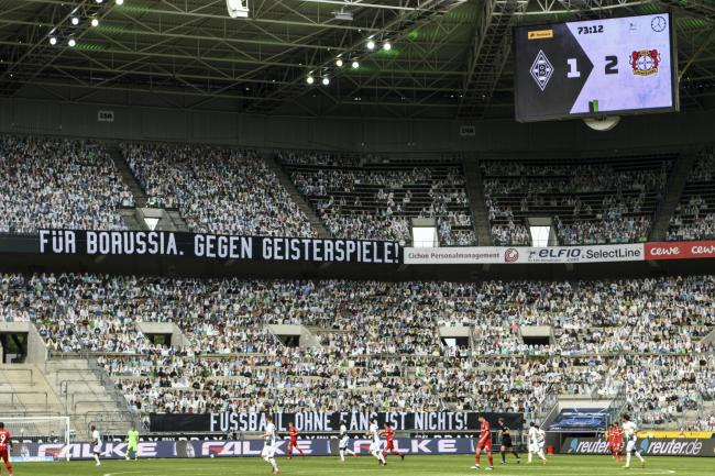 Thousands of cardboard cutouts of fans were used in an otherwise empty stadium at Borssuia-Park (Ina Fassbender/AP)