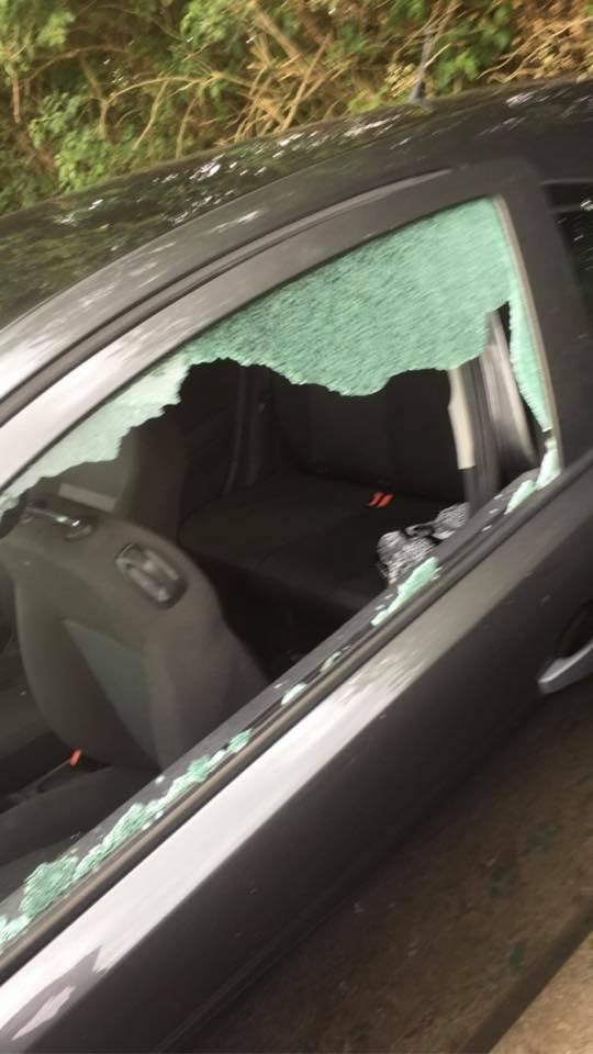 The car's window was smashed during the incident