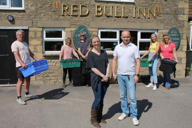 Red Bull Inn owners Dave and Nicola Moody with Heals volunteers setting off on another meal delivery run. The group has now delivered 4,000 meals