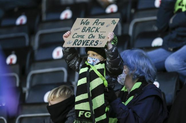 Young Forest Green Rovers supporter during the EFL Sky Bet League 2 match between Forest Green Rovers and Cambridge United at the New Lawn, Forest Green, United Kingdom on 12 December 2020.