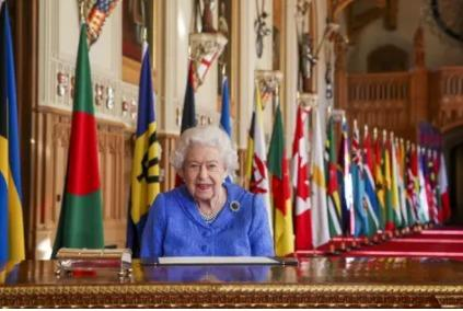 Queen Elizabeth II signs her annual Commonwealth Day Message in St George's Hall at Windsor Castle. image by PAwire/PAimages