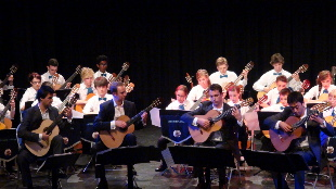 Aquarelle Guitar Quartet (front) supported by The Corinium Players Guitar Ensemble at the Sundial Theatre, Cirencester.