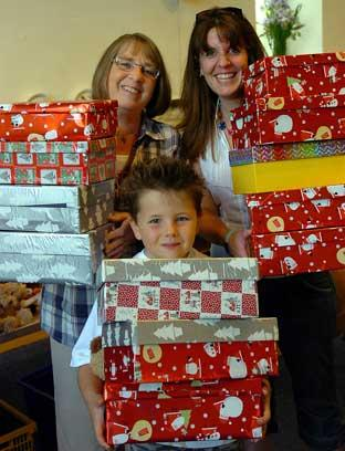 In the family...Operation Christmas Child organiser Joan Townsend with d