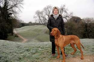 Mary Holker and her dog at the Roman amphitheatre in Cirencester where she spotted a big cat