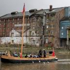 Wilts and Gloucestershire Standard: The Wye Trow, powered by potential crew members, undergoing water trials in Gloucester Docks.