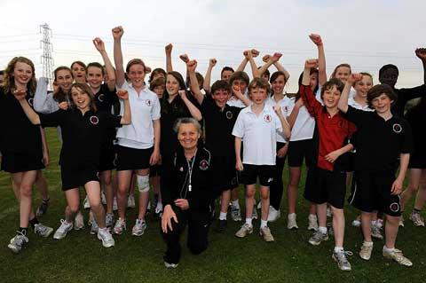 Olympic torchbearer Christina See with some of the Cirencester Kingshill pupils at the after-school athletics club