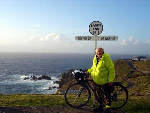 Fundraising cyclist Mick Ponting at Land's End at the start of his epic journey