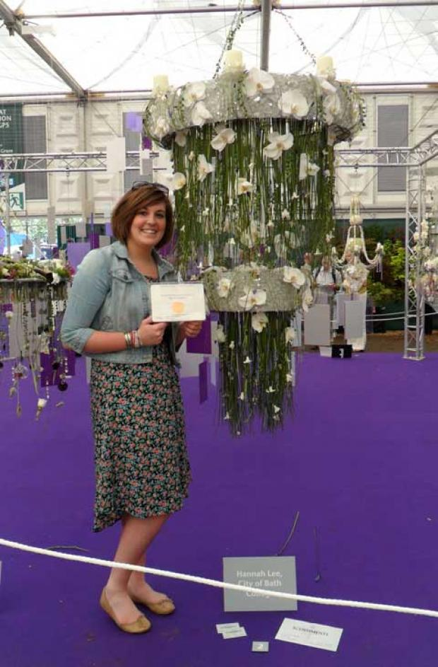 Hannah Lee with her winning flower design at the Chelsea Flower Show