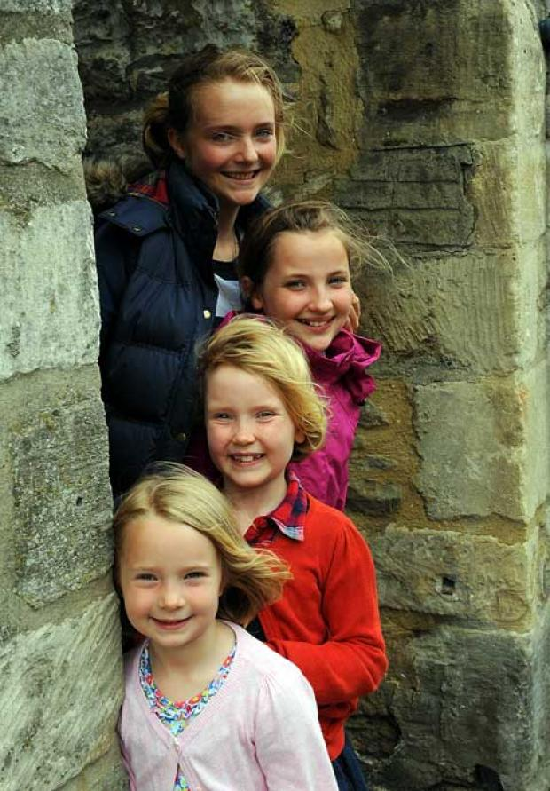 Maya, 13, Anna, 10, Pippa, 7 and Eva Wilson, 5, who think teh alleyway in tetbury shoucl be given a Harry Potter-style name