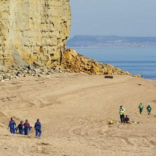 Five people escaped unhurt after a major rock fall along the Jurassic Coast near Charmouth, Dorset