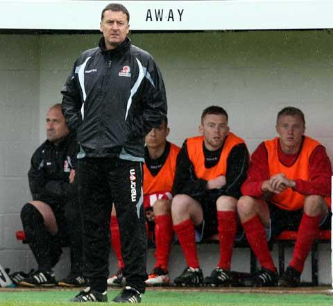 Cirencester Town's frustrated manager Brian Hughes