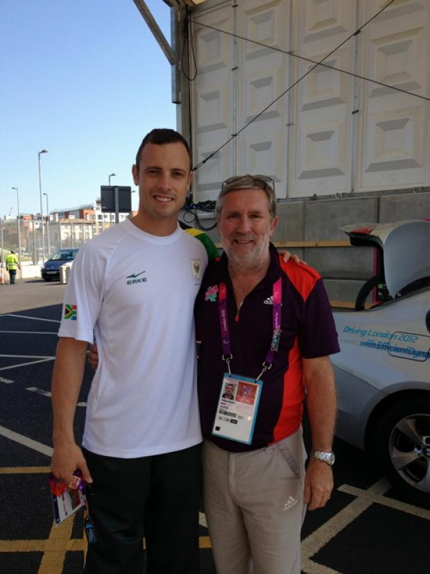 Paralympic Games volunteer William Beach, of Fairford, meets controversial sprinter Oscar Pistorius, shortly after his angry outburst at coming second in the T44 200metres final