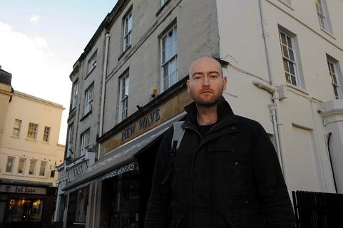 Concerned resident Tom Smith in front of New Wave Fish Shop in Cirencester