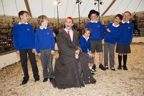 Local school children clown around with Gifford's funny man Tweedy