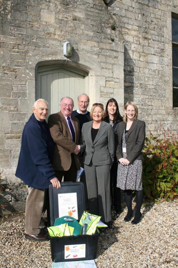 Handing over the battle box: L-R: Barnsley resident Paul Le Bars, Barnsley Parish Meeting chairman Howard Franks, CDC cllr for Ampney-Coln Sir Edward Horsfall, Cllr Carole Topple, CDC officers Roz Brazier and Jennifer Taylor