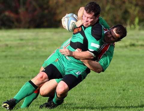 Nathan Waite of Cricklade tackles Fairford's 'Beamer' Chambers