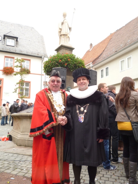 Malmesbury Mayor Ray Sanderson with Mayor of Bad Hersfeld Thomas Fehling with a statue of St Lullus