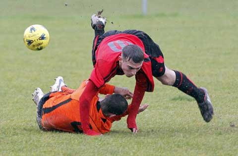 Tetbury's Dave Bricknell makes a sliding challenge against Horsley United