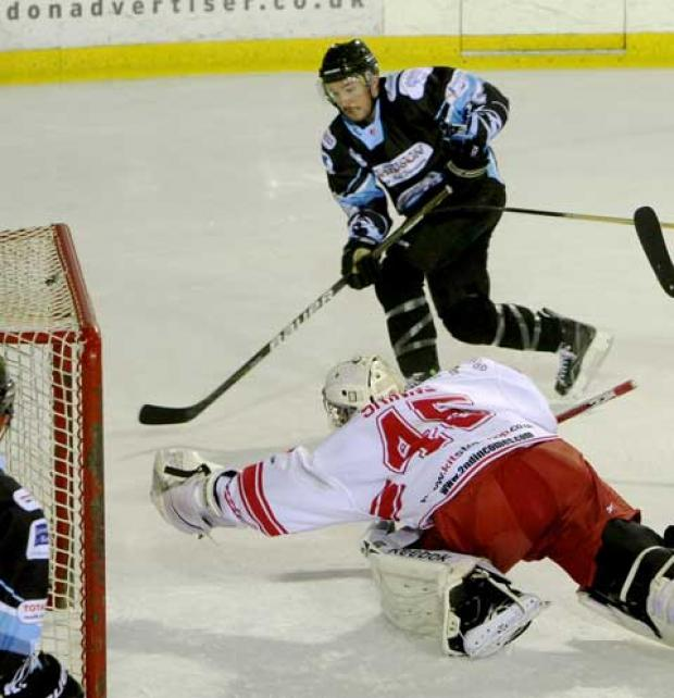 Wilts and Gloucestershire Standard: Wildcats netminder Dean Skinns keeps out a Phoenix attack