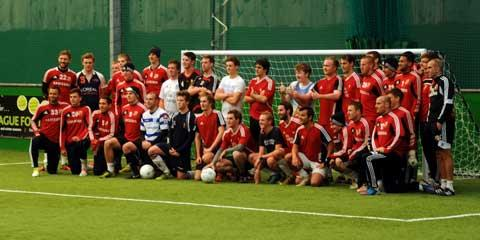 Footballers from the Royal Agricultural College share a photo opportunity with Swindon Town at the Cirencester Arena today