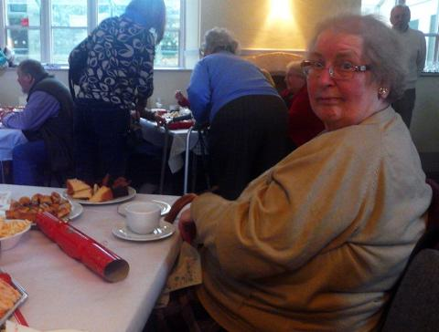 Pat Fitchett enjoys afternoon tea in Fairford Community Centre
