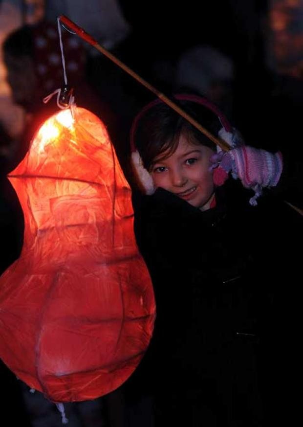 Beth Hawkins, 7, gets her lantern ready for the procession