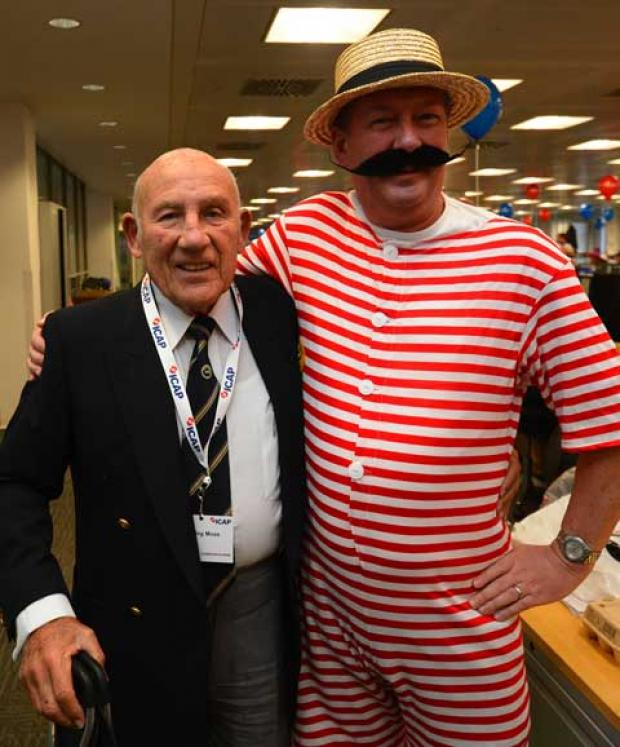 Hope for Tomorrow patron Sir Stirling Moss with a member of staff at the ICAP charity day