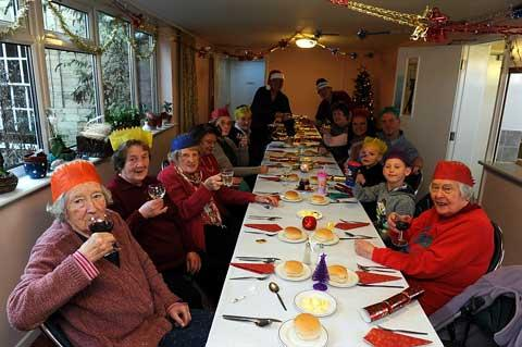 Residents gather for their Christmas lunch at St Clements community room in Cirencester