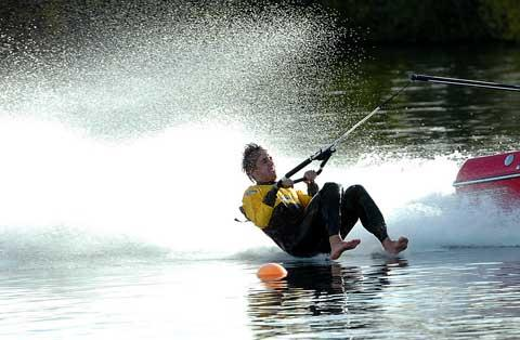 Wilts and Gloucestershire Standard: Dom Drew in action at the barefoot water ski event near South Cerney