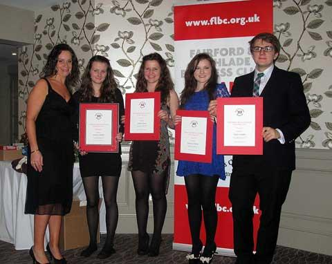 Business club vice chairman Helen Webb, with (from left to right) business student winner Georgia Holland and runners up Claudia Mears, Bryony Stephens and Hugh Campkin (picture by Chris Roberts)