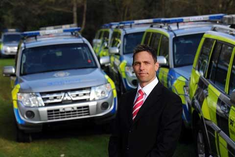 Dan Pigot, Corporate Sales Manager - Specialist Vehicles, with some of the fleet of police vehicles awaiting delivery at Mitsubishi Motors in Cirencester
