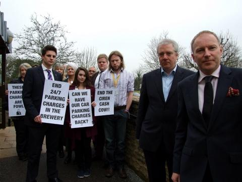 Members of the Cotswold Liberal Democrats vented their frustration over parking charges at Cotswold District Council's Cirencester headquarters yesterday
