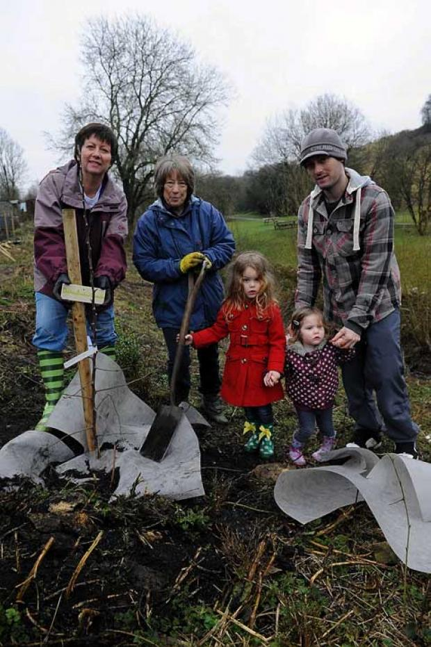 Planting an apple tree in the new Tetbury Community Orchard are Anne Smith, Jenny Miles and Ross Hampton with daughters Liara and Lexie