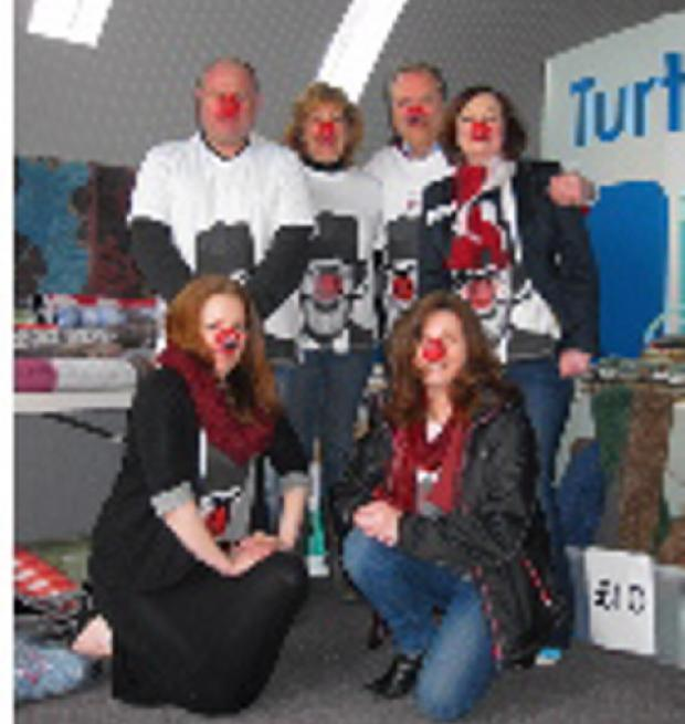 Staff at Turtle Mats, Cotswold Airport, near Kemble selling their mountain of mats at bargain prices to raise money for Red Nose Day