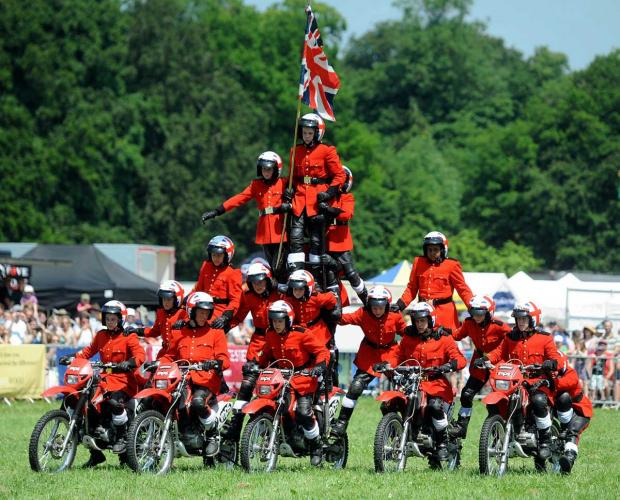 Members of the Imps motorcycle display team in 2013 perform their pyramid formation