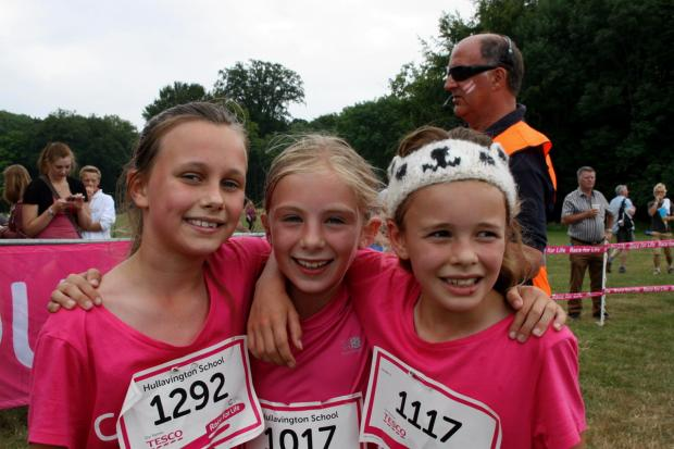 From left: Chloe Jones, Alice Hathaway and Georgie Thompson from Hullavington Primary School at Last Year's Race for Life Event at Cirencester Park