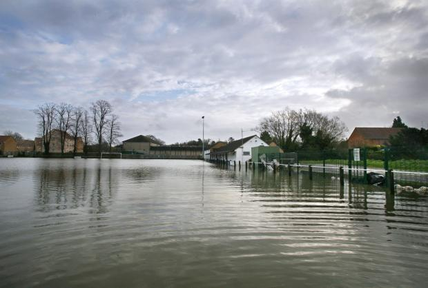 Wilts and Gloucestershire Standard: The Malmesbury Victoria football ground during the worst of the floods