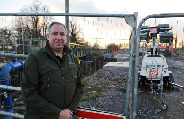 Wilts and Gloucestershire Standard: Parish councillor John Buckley at the closed bridge south of Luckington.