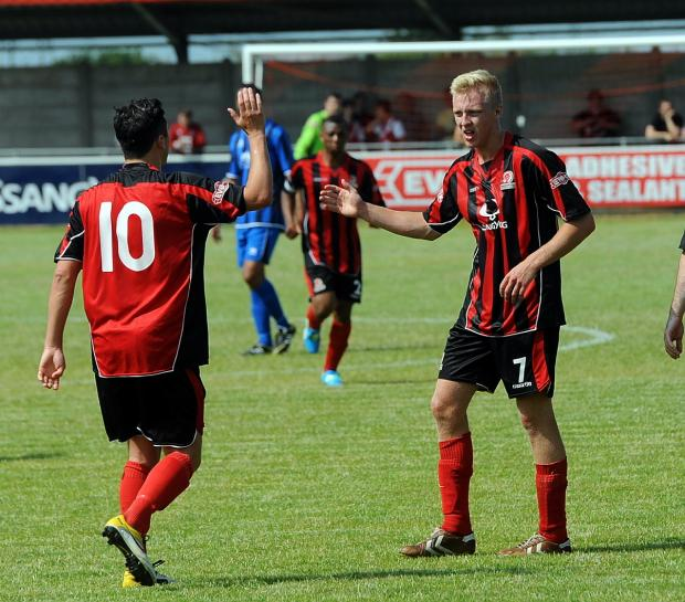 Joe Shepherd, right, the scorer of Cirencester Town's goal in the Red Insure Cup against Hungerford
