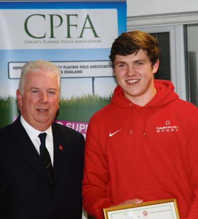Rising rugby star Harry Wilson collects his award from Patrick Brooke of The Honourable Company of Gloucestershire
