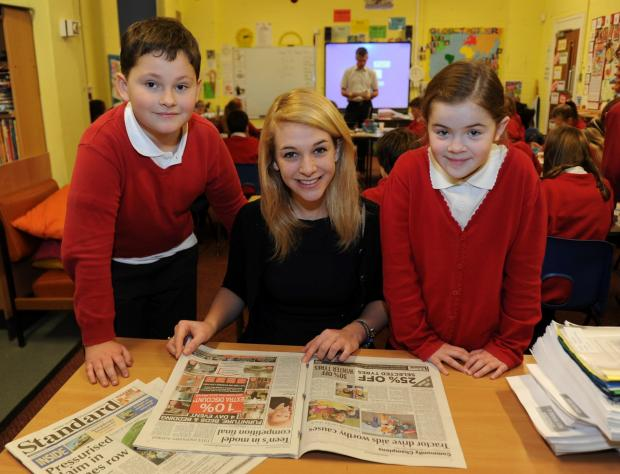 Standard reporter Megan Archer with Cirencester Primary School pupils Peter Gray and Olivia Skelton, both aged nine